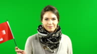 Young woman waving the Switzerland flag on Green Screen background video