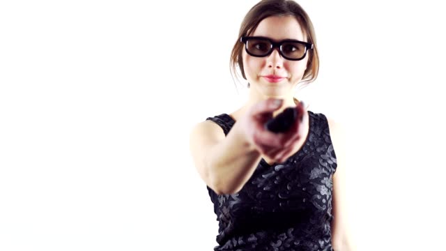 Young woman wearing 3d glasses and holding remote controller isolated on white background video