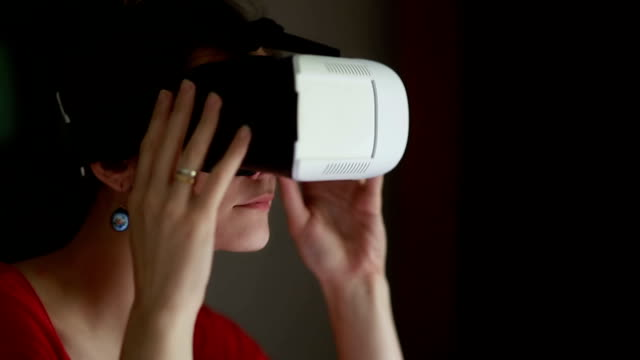 Young woman wearing virtual reality glasses video