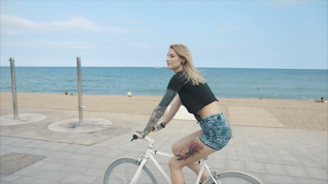 Young Woman with a Bicycle video
