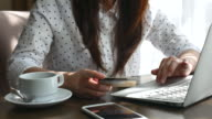 Young woman with a credit card shopping online, shopping online, Paying video