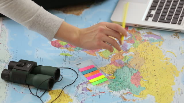 Young woman with a map planning a trip. video