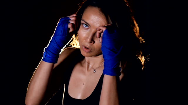 Young woman with boxing handwraps trainig. video