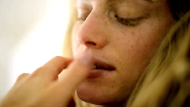 Young woman with freckles, close-up video