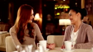 Young woman with friend in a restaurant video