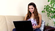 Young woman with laptop video