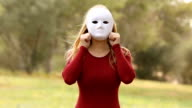 young woman with mask faking emotions video