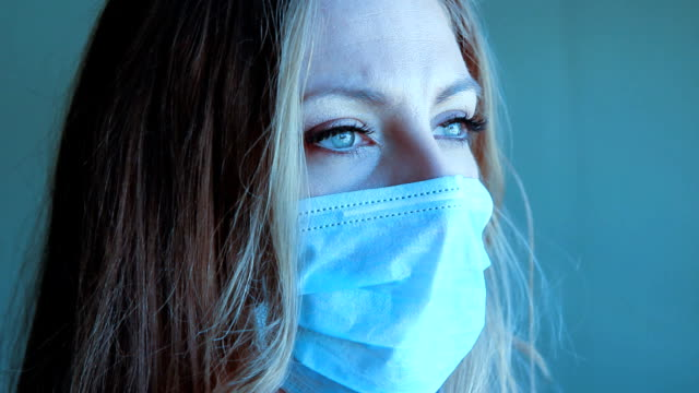 Young woman with medical mask. Two shots. video