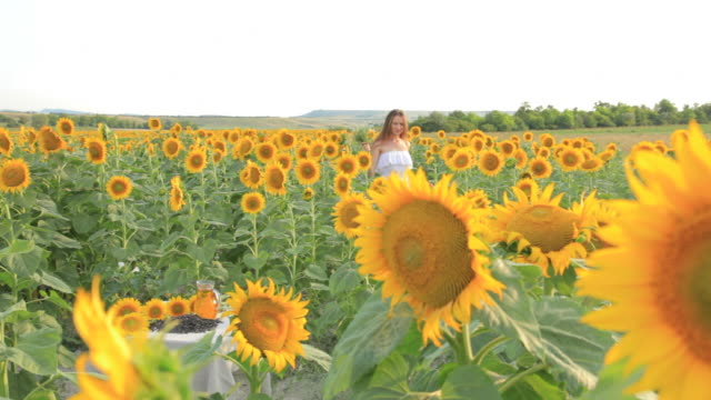 HD Young woman with sunflower oil jug video