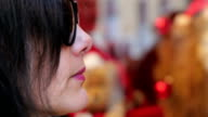 Young woman with sunglasses, closeup, profile video