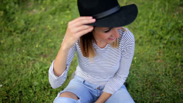 Young woman with the hat,laughing,flirting video
