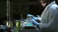 Young woman working in a lab video
