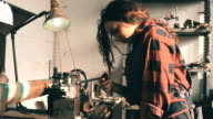 Young woman working on lathe machine in a workshop video