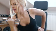 Young woman working out: gym/Pilates/Yoga/Bootcamp. And drink water video