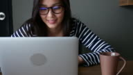 Young Woman working With eyeglasses and Laptop video