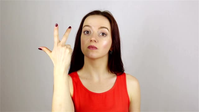 Young womans hand counting down from five using her fingers video