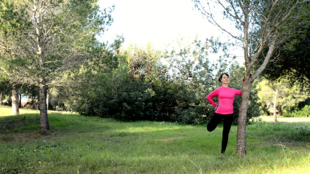 young women doing fitness exercise outdoors in the nature video