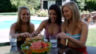 Young Women Eating Burgers at Barbecue video