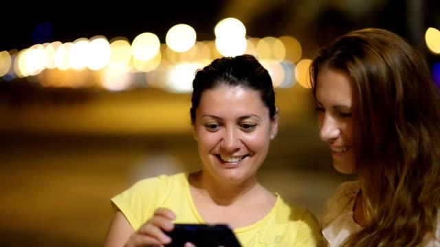 Young women enjoying night tourism video
