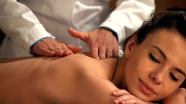Young women getting back massage in spa salon video