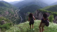 Young women hiking in the mountain video