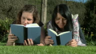 HD: Young women smile while reading a book video
