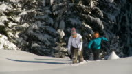 HD SLOW-MOTION: Young Women Snowshoeing video