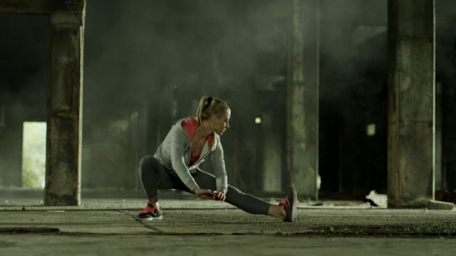 Young women stretching during jogging video