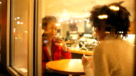 Young women talking over coffee video