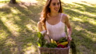 Young women walking with basket of groceries video
