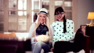 Young women watching TV together video