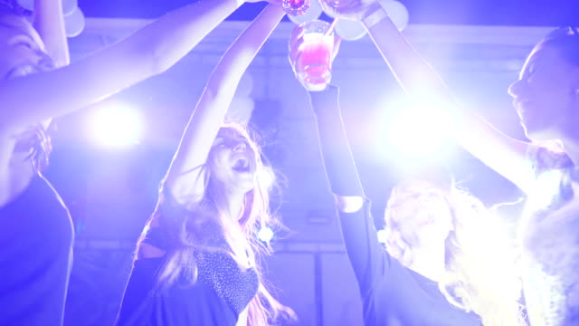 young Women with bright drink at disco club, female dancing at nightclub, sexy women dancing at night party video