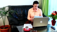 Young Women with Laptop computer and bills video