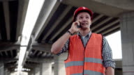 Young worker talking on mobile phone video