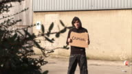 Youth / Hoody holding sign saying 'Criminal' video