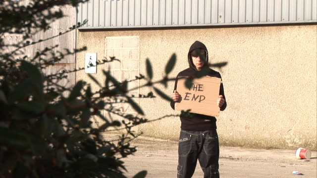 Youth / Hoody holding sign saying 'The End' video
