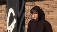 Youth Hoody leaning against wall looking depressed video