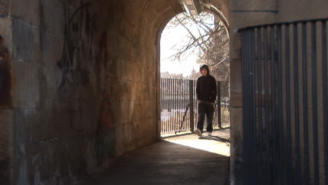 Youth / Hoody walking in tunnel - HD & PAL video