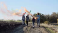 Youth with colored smoke grenades video