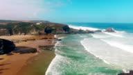 Zambujeira do Mar beach, Alentejo, Portugal aerial view video