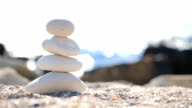 Zen symbol from stones on the beach and the sea on background video