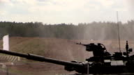 Zhukovsky. Russia. 17 aug 2014: Russian army. Tank T-80U shoots on hill in moving. video