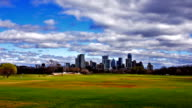 Zilker Park Austin Texas 2016 on a perfect day in early spring as the sun comes out and clouds bring rain and grass turns green Capital City Skyline video