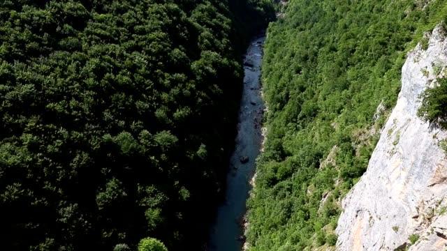 Zip line adventures in Tara canyon high above Tara river Montenegro. Tilting up shot. video