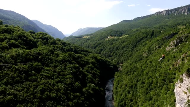 Zip line adventures in Tara canyon high above Tara river Montenegro. Dolly shot. video