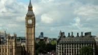 zoom in on big ben over westminster bridge during the day video