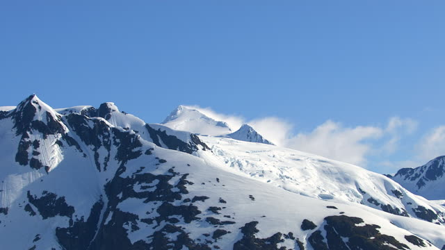 Zoom out from snowy mountain peak, Alaska video