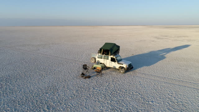 Zoom out high aerial view of tourists camping on the vast Makgadikgadi Pans video