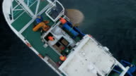 Zoom Out of a Commercial Fishing Ship where People processing the Fish. Top down view. video