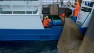 Zoom out of a Commercial Ship Fishing with Trawl Net on the Sea. video